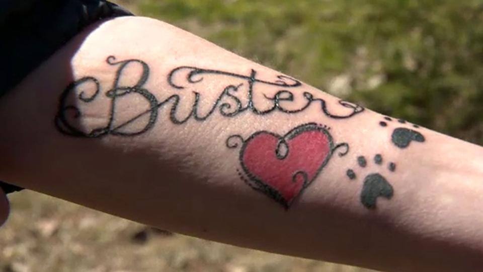 Rosalie Stelmack shows her tattoo, commemorating her dog Buster.