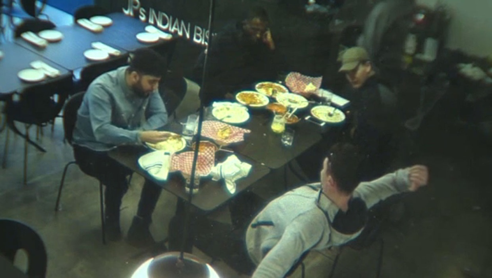 Four of the six men involved in an allegedly dine-and-dash are seen on security video taken from inside the restaurant.