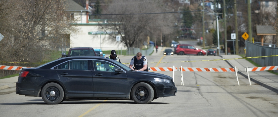 RCMP officers work behind barricades near the Salmon Arm Church of Christ in Salmon Arm, B.C. on Sunday, April 14, 2019. THE CANADIAN PRESS/Murray Mitchell