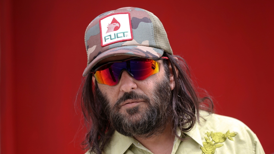 """Los Angeles artist Erik Brunetti, the founder of the streetwear clothing company """"FUCT,"""" poses for a photo in Los Angeles Thursday, April, 11, 2019. (AP Photo/Damian Dovarganes)"""