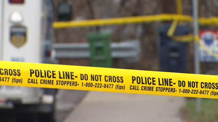 Police tape surrounds an area in Toronto's west-end where homicide detectives are investigating the death of a man on April 15, 2019.