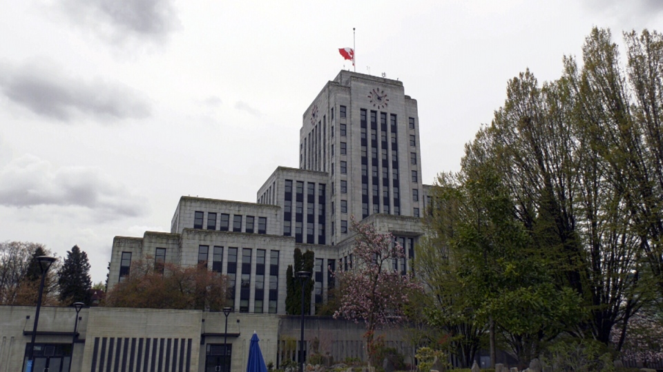 A flag at Vancouver City Hall was lowered to half-mast on Sunday, marking the anniversary of a public health emergency in B.C.