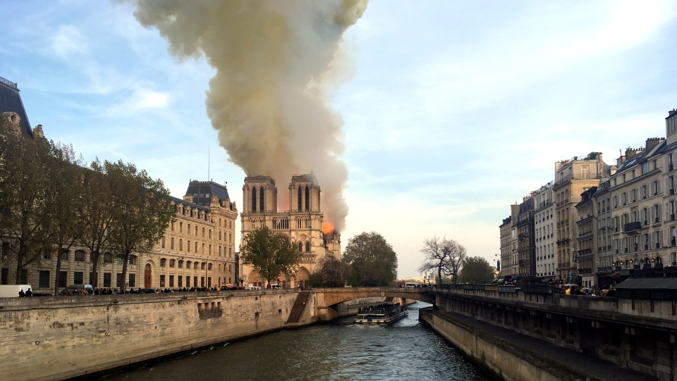 Notre Dame cathedral is burning in Paris, Monday, April 15, 2019. (AP Photo/Lori Hinant)