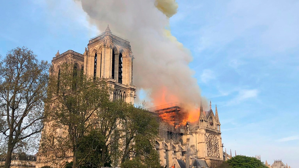Notre Dame cathedral is burning in Paris, Monday, April 15, 2019.  (AP Photo)