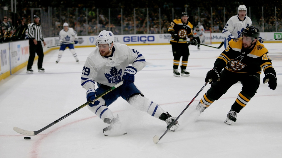 Toronto Maple Leafs right wing William Nylander (29) controls the puck ahead of Boston Bruins defenseman Matt Grzelcyk (48) during the first period of Game 2 of an NHL hockey first-round playoff series, Saturday, April 13, 2019, in Boston. THE CANADIAN PRESS/AP Photo/Mary Schwalm