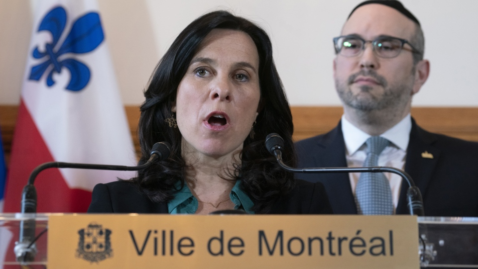 Montreal mayor Valerie Plante responds to a question as opposition leader Lionel Perez looks on during a news conference in Montreal on Monday, April 15, 2019. (THE CANADIAN PRESS / Paul Chiasson)