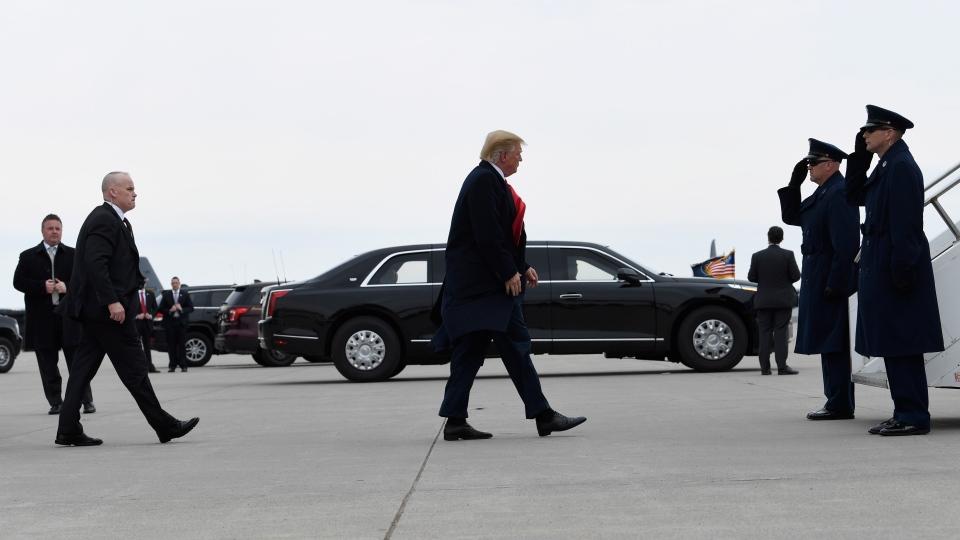 U.S. President Donald Trump walks towards the steps of Air Force One at Minneapolis-Saint Paul Air Reserve Station in Minneapolis, Monday, April 15, 2019. (AP Photo/Susan Walsh)