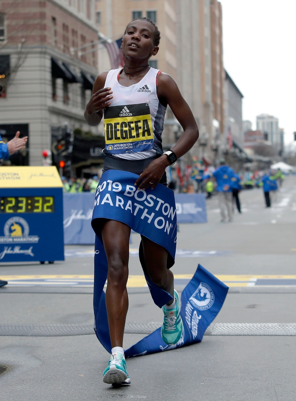 Worknesh Degefa, of Ethiopia, breaks the tape to win the women's division of the 123rd Boston Marathon on Monday, April 15, 2019, in Boston. (AP Photo/Winslow Townson)