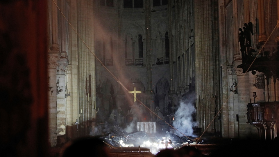 Smoke is seen in the interior of Notre Dame cathedral in Paris, Monday, April 15, 2019. (Philippe Wojazer/Pool via AP)