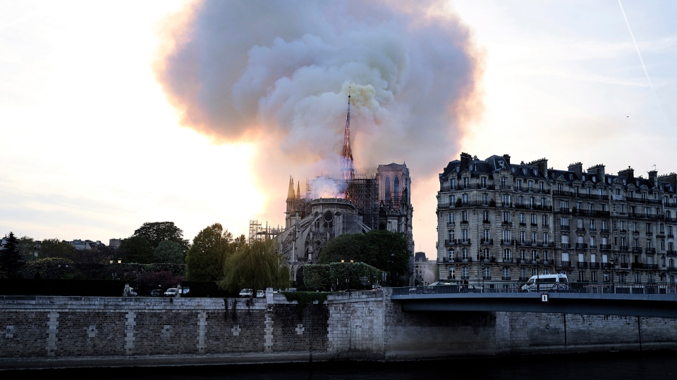 Flames and smoke rise as the spire on Notre Dame cathedral starts to collapse in Paris, Monday, April 15, 2019. (AP / Diana Ayanna)