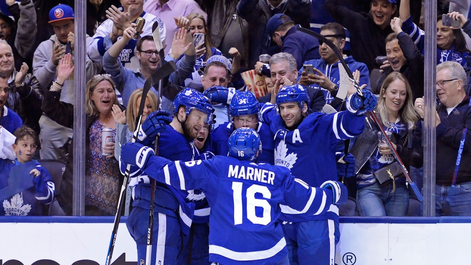 Toronto Maple Leafs centre Auston Matthews (34) celebrates his goal against the Boston Bruins with teammates during second period NHL playoff hockey action in Toronto, on Monday, April 15, 2019. THE CANADIAN PRESS/Nathan Denette