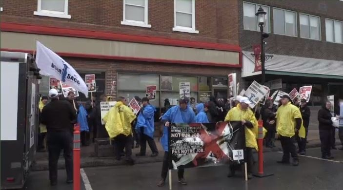 Correctional officers marched outside the office of MP Bill Casey in Truro on Monday afternoon.