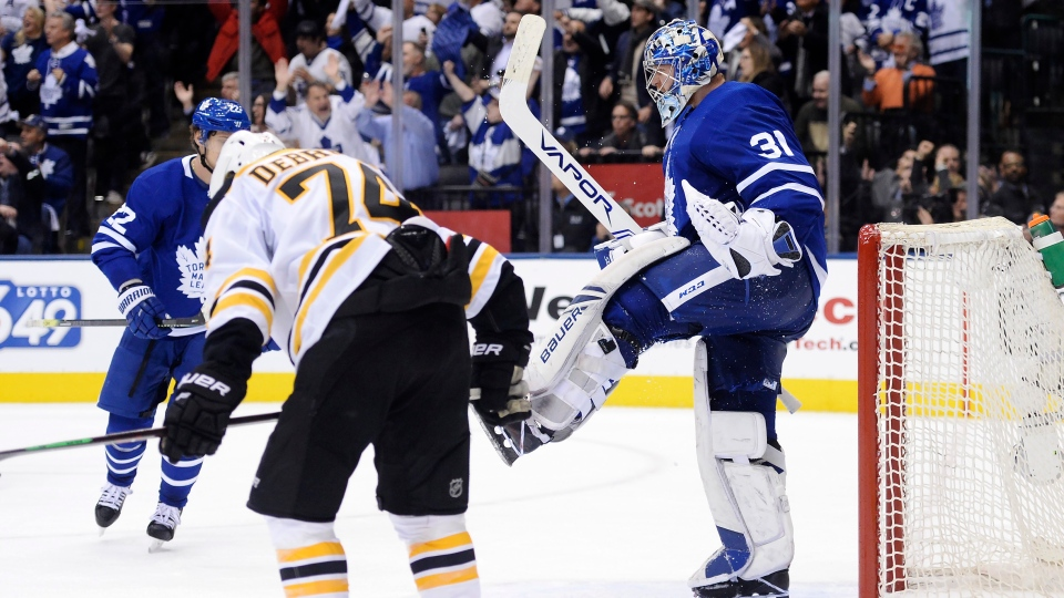 Toronto Maple Leafs goaltender Frederik Andersen (31) celebrates after defeating Jake DeBrusk (74) and the Boston Bruins in NHL playoff hockey action in Toronto, on Monday, April 15, 2019. THE CANADIAN PRESS/Nathan Denette