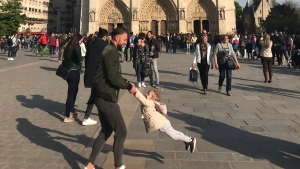 Brooke Windsor tweeted out an image of a man swinging a girl in front of Notre Dame cathedral moments before it caught fire. (Brooke Windsor / Twitter)