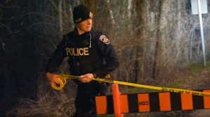 A Hamilton police officer cordons off the area where a 17-year-old boy was found dead near Patterson and Wesley roads Monday April 16, 2019.