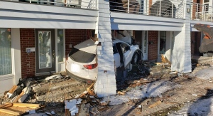 A vehicle smashed into a home on Nautica Priv. off of Carling Ave. Tuesday morning. One woman has been injured. (Ottawa Fire / Twitter)