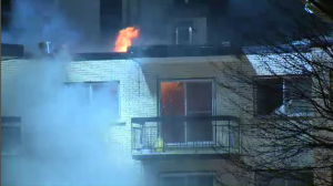 Montreal police and firefighters were called to the scene of a five-alarm fire in a 200-unit apartment complex in Pierrefonds late Monday night. Tenants have been taken into the care of the Red Cross. (Cosmo Santamaria/CTV Montreal)