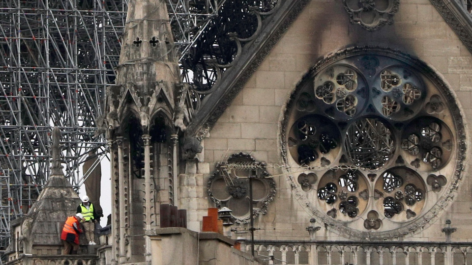 Experts inspect the damaged Notre Dame cathedral after the fire in Paris, Tuesday, April 16, 2019. (AP Photo/Kamil Zihnioglu)