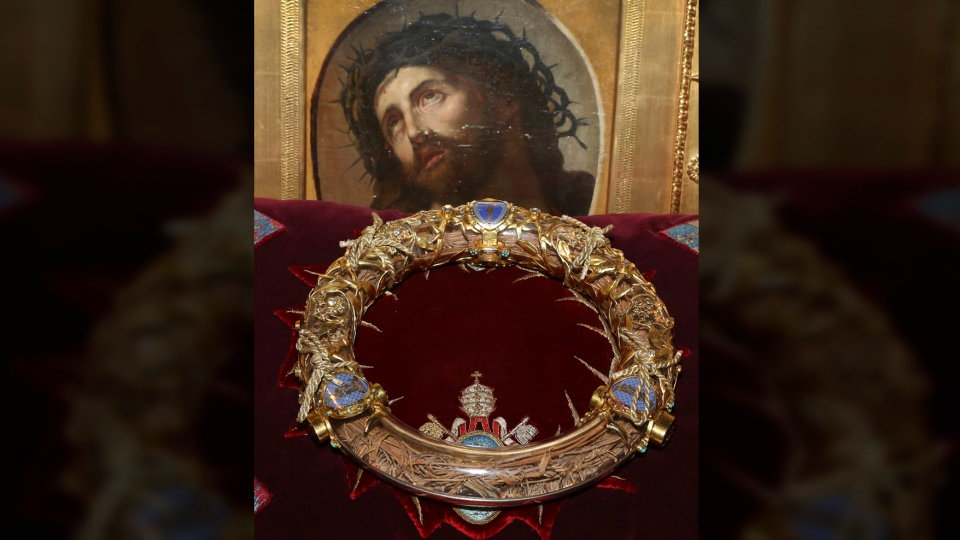 In this Friday March 21, 2014 file photo a crown of thorns which was believed to have been worn by Jesus Christ and which was bought by King Louis IX in 1239 is presented at Notre Dame Cathedral in Paris. (AP Photo/Remy de la Mauviniere, File)