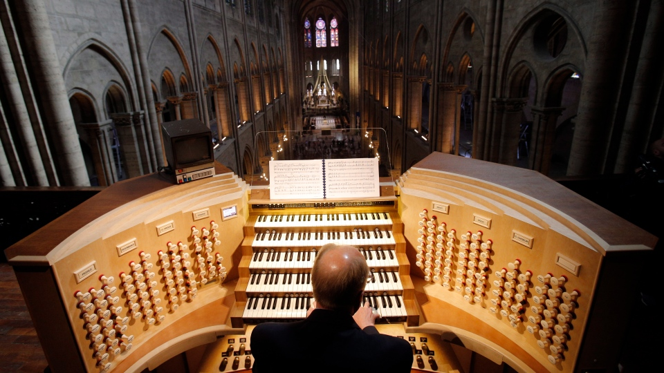 In this Thursday, May 2, 2013 file photo, Philippe Lefebvre, 64, plays the organ at Notre Dame cathedral in Paris. (AP Photo/Christophe Ena, file)