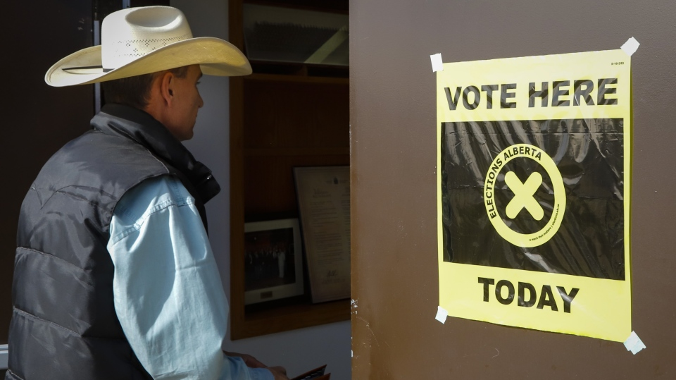 A voter arrives to cast a ballot at a rural poling station in Cremona, Alta., Tuesday, April 16, 2019. THE CANADIAN PRESS/Jeff McIntosh