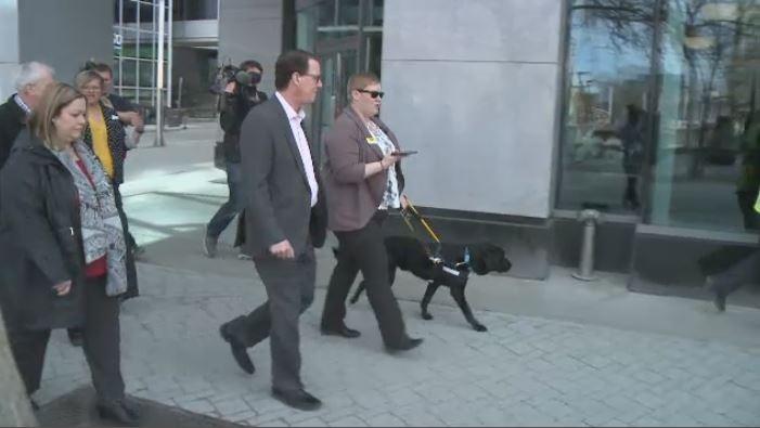 Ashley Nemeth and Danson use the BlindSquare app to navigate through downtown Regina