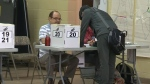Voters head to polls in 'divisive' campaign