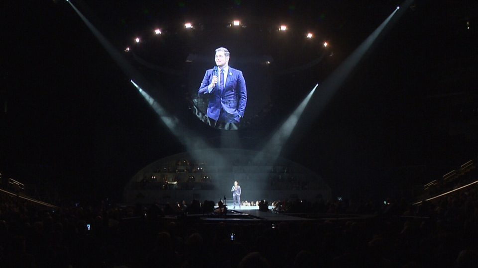 Michael Buble speaks during a concert in Edmonton on Monday, April 16, 2019.