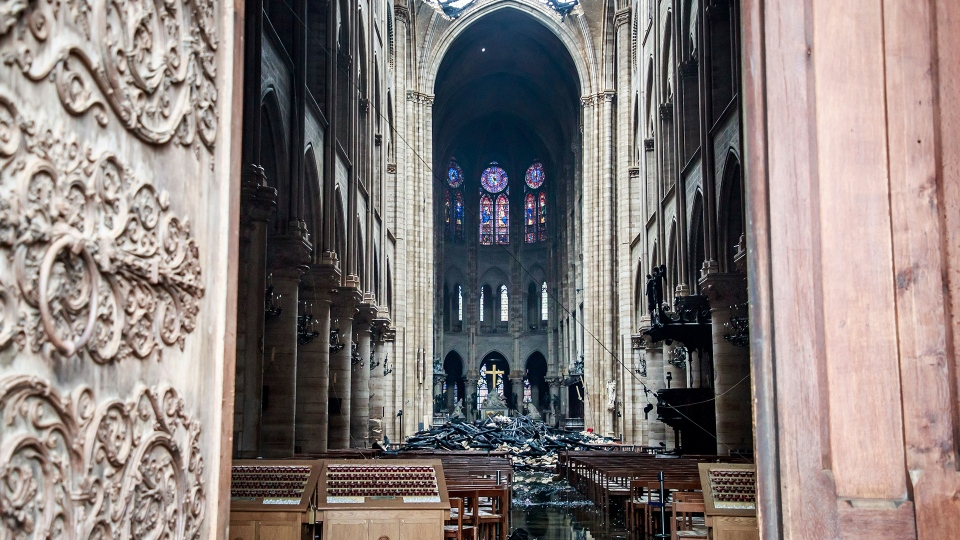 A hole is seen in the dome inside Notre Dame Cathedral in Paris, Tuesday, April 16, 2019. (Christophe Petit Tesson, Pool via AP)
