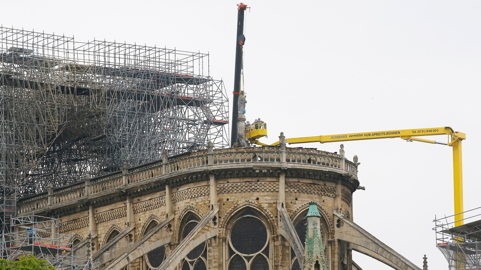 Experts prepare to remove a statue from the damaged Notre Dame cathedral after the fire in Paris, Tuesday, April 16, 2019. (AP / Michel Euler)