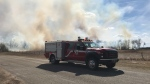 The Saskatoon Fire Department is responding to a grass fire which started near Riverside Estates and moved into Cranberry Flats. (Dale Cooper/CTV Saskatoon)