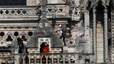 Firefighters work at Notre Dame cathedral Wednesday, April 17, 2019 in Paris. French President Emmanuel Macron ratcheted up the pressure by setting a five-year deadline to restore the 12th-century landmark. (AP Photo/Francois Mori)