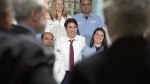 Prime Minister Justin Trudeau poses with workers as he visits the biotechnology company BioVectra Inc. in Charlottetown on Monday, March 4, 2019.  (THE CANADIAN PRESS/Andrew Vaughan)