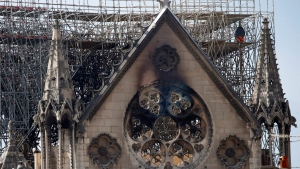 Damage on the facade at the Notre Dame Cathedral, in Paris, Wednesday, April 17, 2019. (AP Photo/Christophe Ena)