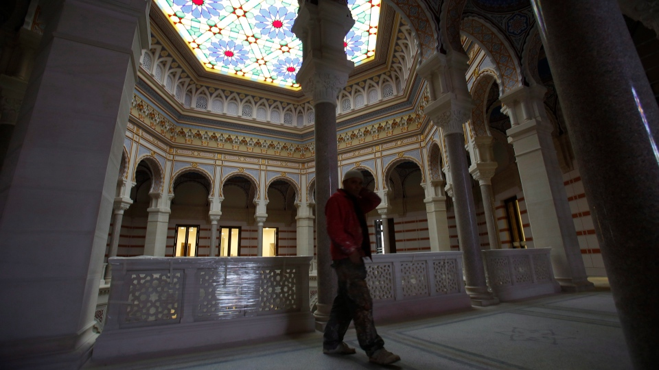 A worker walks trough the Sarajevo National Library Friday, April 11, 2014. (AP Photo/Amel Emric)