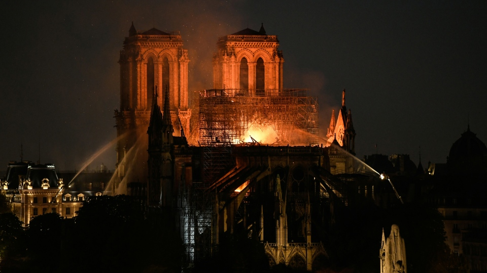 Some 400 firefighters tackled the huge blaze at the Notre Dame cathedral in Paris, oblivious to the danger they faced, and saw their efforts rewarded as they saved the main structure. (Bertrand Guay / AFP)