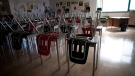 A vacant teachers desk is pictured at the front of a empty classroom is pictured at McGee Secondary school in Vancouver on Sept. 5, 2014.  THE CANADIAN PRESS/Jonathan Hayward