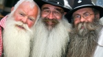 Second placed Ernst Schuster from Germensdorf in Germany, winner Albert Schmid from Samstagern in Switzerland and third placed Willi Preuss from Sulzbach in Germany from left, pose for photographers after an international beard contest in Chur, Switzerland, Sunday, Aug. 21, 2011. (AP Photo/Keystone, Arno Balzarini)