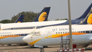 In this April 15, 2019, file photo, Jet Airways aircrafts are seen parked at Chhatrapati Shivaji Maharaj International Airport in Mumbai. India's Jet Airways said Wednesday, April 17, that it is suspending all operations after failing to raise enough money to run its services. (AP Photo/Rafiq Maqbool, File)
