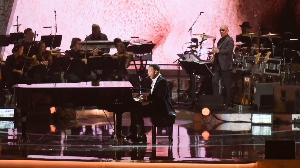 In this Feb. 12, 2019 file photo, John Legend performs during Motown 60: A GRAMMY Celebration at the Microsoft Theater in Los Angeles. (Photo by Richard Shotwell/Invision/AP)