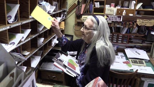 Eileen O'Krafka, 91, sorts mail in Rostock, Ont. on Wednesday, April 17, 2019. (Scott Miller / CTV London)
