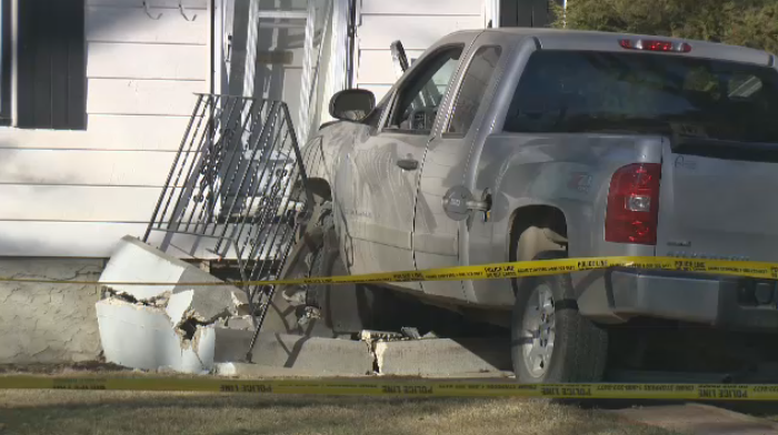 A man has died after the truck he was driving collided with a house on Wednesday morning.