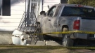 Man dies after truck crashes into house.