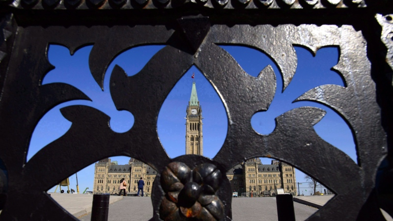 The centre block of Parliament Hill is seen from the front gates in Ottawa on April 23, 2018. THE CANADIAN PRESS/Sean Kilpatrick