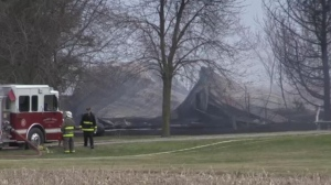 A barn destroyed by fire is seen near Strathroy, Ont. on Wednesday, April 17, 2019.