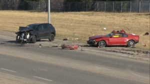 Damaged vehicles along Peigan Trail following Wednesday afternoon's fatal head-on crash