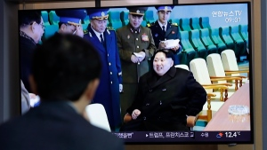 A man watches a TV news program reporting about North Korea's test-fire of a 'new-type tactical guided weapon,' with a footage of North Korean leader Kim Jong Un, at the Seoul Railway Station in Seoul, South Korea, Thursday, April 18, 2019. (AP Photo/Lee Jin-man)