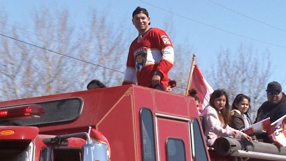 Brady Keeper, the first hockey player from Pimicikamak Cree Nation to reach the NHL, is seen during a parade in his home community.