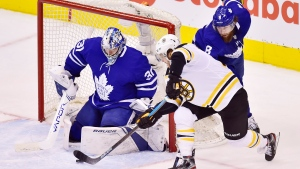 Boston Bruins right wing David Pastrnak (88) shots on Toronto Maple Leafs goaltender Frederik Andersen (31) during third period NHL playoff hockey action in Toronto on Wednesday, April 17, 2019. THE CANADIAN PRESS/Frank Gunn