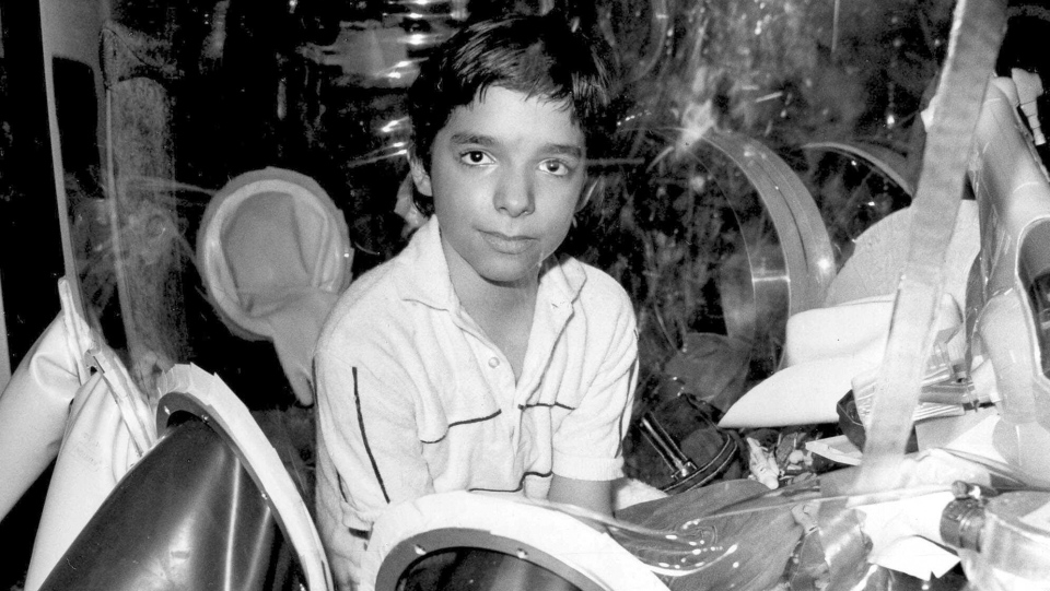 FILE - This Sept. 11, 1982, file photo shows David Vetter, born with an inherited disorder which leaves him no natural immunities against disease, in his protective enclosure in Texas. (AP Photo/File)